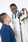 Doctor Checking Boy's Weight — Stockfoto