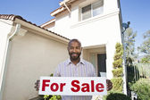 "Portrait Of An Estate Agent Holding ""For Sale"" Sign — Stock Photo"