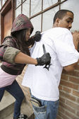 Young Woman Robbing Man With Knife — Stock Photo