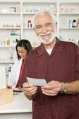 Man Picking Up Prescription Drugs At Pharmacy — Stock Photo