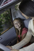 Daughter sitting in car with her mother — Stock Photo