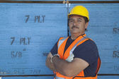 Portrait of a warehouse worker with arms crossed — Stock Photo