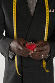 Mid section of man wearing suit holding pincushion — Stock Photo