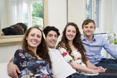 Portrait of friends sitting on sofa — Stock Photo