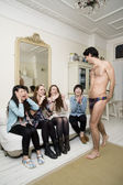 Male stripper performing in front of young females — Stock Photo