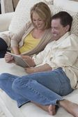 Happy Couple Using Digital Tablet — Stock Photo