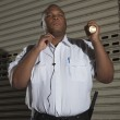 Security Guard Holding A Torch Light — Stock Photo #24459931