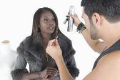 Model Looking At Makeup Artist — Stock Photo