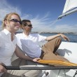 Multiethnic Couple Sailing On Sailboat — Stock Photo
