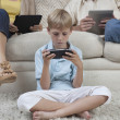Little Boy Playing Game On PSP — Stock Photo #24460255