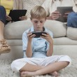 Stock Photo: Little Boy Playing Game On PSP