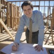 Male Architect Writing Plan On Blueprint — Stockfoto