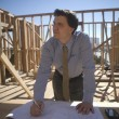 Architect Working On Blueprint At Site — Stock Photo