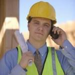 Architect Using Cell Phone While Holding Blueprint — Stock Photo