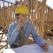 Architect Working On Blueprint At Site — Stock Photo #24460391