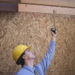 Architect Inspecting Framework With Measure Tape — Stock Photo