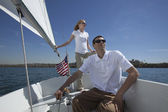 Multiethnic Couple On Sailboat — Stock Photo