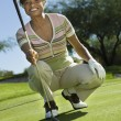 Senior woman on golf course — Stock Photo