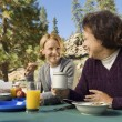 Women Sitting at Picnic Table — Stock Photo
