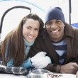 Couple lying in sleeping bags in tent — Stock Photo #33795591