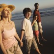 Family walking on beach — Stock Photo #33795805