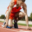 Male runner waiting at starting block — Stock Photo #33795845