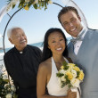 Bride and Groom With Priest  — Stock Photo