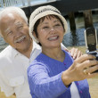 Stock Photo: Senior couple photographing themselves