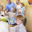 Boy with family having a retirement party — Stock Photo