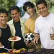 Men at outdoor grill. — Stock Photo
