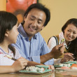 Family Eating Sushi — Stock Photo