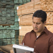 Stock Photo: Male supervisor stock taking in warehouse