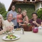Friends enjoying dinner party — Stock Photo