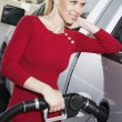 Woman refueling her car at the gas station — Stock Photo #33797333