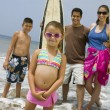Little Girl with Her Family on Beach — Stock Photo
