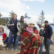 Stock Photo: Multiethnic friends at campsite