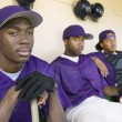 Players sitting in dugout — Stock Photo #33797901