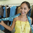Girl Trying on Sequin Boa — Stock Photo