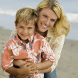 Mother and Son on Beach — Stockfoto