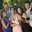 Stock Photo: Friends Being Videotaped at School Dance