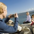Mother taking picture of daughters — Stock Photo