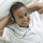 Boy Listening to Music — Stock Photo #33798571