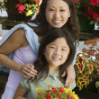 Mother with daughter holding flowers — Stock Photo #33798685