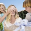 Daughter covering eyes of mother — Stock Photo