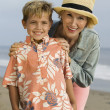 Stock Photo: Grandmother and Grandson on Beach