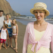 Grandmother with Family at Beach — Stock Photo