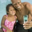 Grandfather and Granddaugther Posing for Camera Phone — Stock Photo