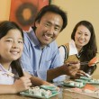 Stock Photo: Family Eating Sushi