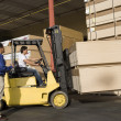 Warehouseman and forklift truck driver — Stock Photo