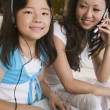 Mother and Daughter Using Laptop and Cell Phone — Stock Photo